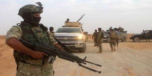 القوات العراقية تلقي القبض على مطلوبين وتصادر أسلحة شرق بغداد